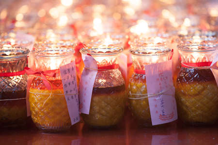 Burning candles in Quan Yin temple Stock Photo - 36606661