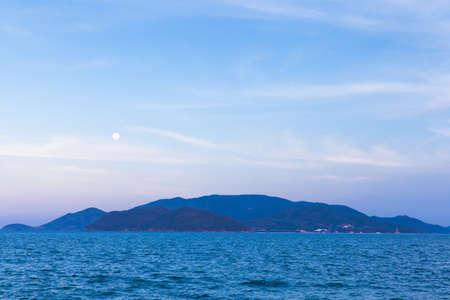 trang: Full moon rises over Nha Trang beach, Vietnam.
