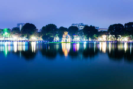 small sword: Tortoise Tower is a small tower in the middle of Sword Lake, Hanoi, Vietnam. Stock Photo
