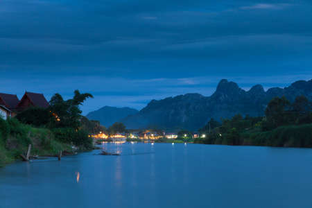 nam: Nam Song river after sunset, Vang Vieng village, Laos