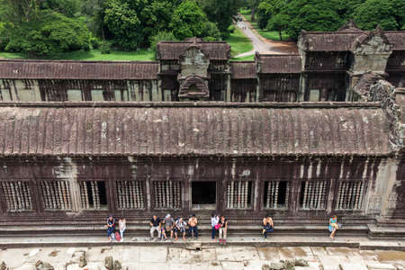 Siem Reap, Cambodia - 25 June, 2014: The group of tourists resting in Angkor Wat Temple on June 25, 2014, Siem Reap, Cambodia.