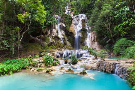 Kuang Si Waterfalls beautiful cascade of blue waterfalls near Luang Prabang town in Laos. Stock Photo