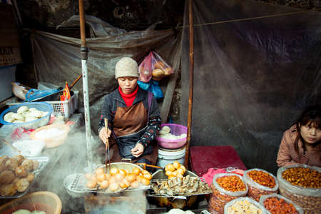 vietnamese ethnicity: Sapa Lao Cai Vietnam 6 May 2014: Vietnamese woman selling food on the local market Sapa Northern Vietnam on 06 May 2014.