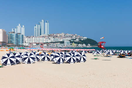 Busan South Korea August 22 2014: The view of Haeundae beach one of the popular beaches of Busan Metropolitan City the largest port of South Korea the host city of the 2002 Asian Games and APEC 2005 Korea on 22 August 2014 in Busan South Korea.
