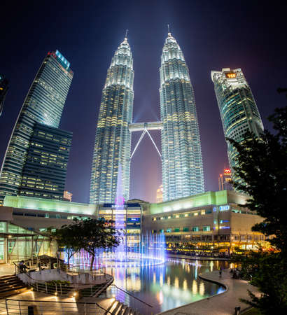 twin tower: Fountain show at night in front of Petronas Twin Towers and Suria KLCC mall Kuala Lumpur Malaysia. Editorial