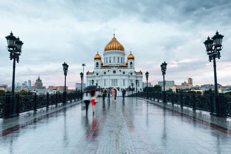 tallest bridge: Sunset over Cathedral of Christ the Saviuor in rainy weather on July 7, 2015, Moscow, Russia. Editorial