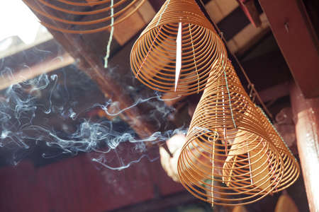 hoi an: Burning incense in Quan Cong Temple, Hoi An, Vietnam Stock Photo