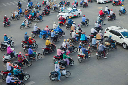 chaotically: Ho Chi Minh City, Vietnam - November 24, 2015: Motorbike drivers are chaotically moving on the road on November 24, 2015 in Ho Chi Minh City, Vietnam. Editorial
