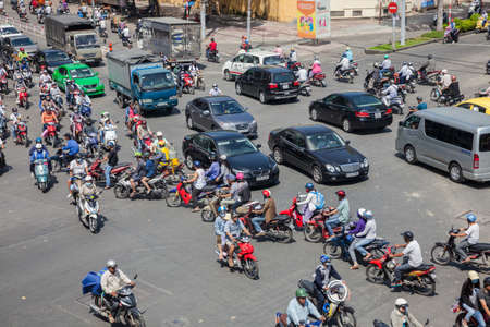 chaotically: Ho Chi Minh City, Vietnam - November 21, 2015: Motorbike drivers are chaotically moving on the road on November 21, 2015 in Ho Chi Minh City, Vietnam.