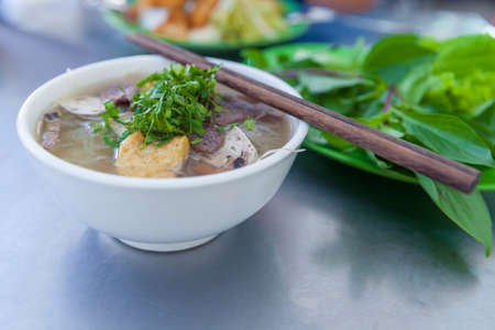 vietnamse: Vegan version of Pho famous vietnamse noodle soup, served with fresh herbs at the buddhist eatery, Nha Trang, Vietnam.