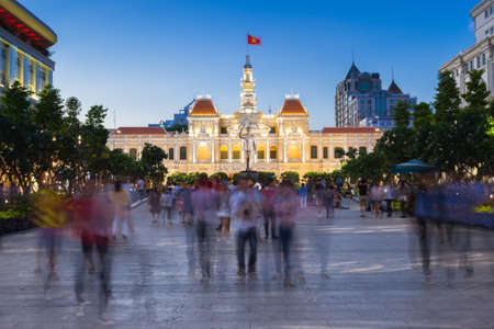 city by night: Ho Chi Minh City, Vietnam - February 14, 2016: People are walking and taking pictures in front of the City Hall building, Ho Chi Minh City, Vietnam on February 14, 2016.