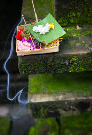 Box with traditional balinese morning offerings or Canang sari, Ubud, Bali, Indonesia Stock Photo - 56451803