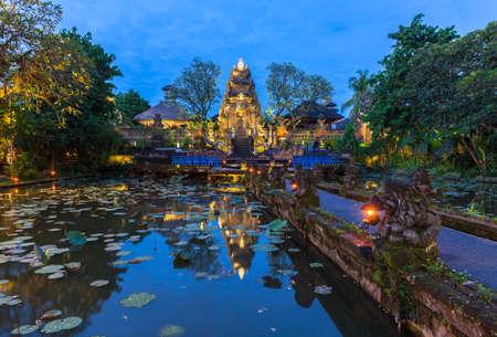 saraswati: Pura Saraswati Temple with beatiful lotus pond at dusk before the dancing show, Ubud, Bali, Indonesia Stock Photo