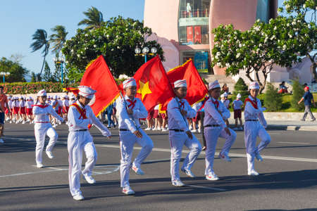 communistic: Nha Trang, Vietnam - May 31, 2016: Pioneer children march on the parade at the end of the school year in Nha Trang, Vietnam on May 31, 2016.