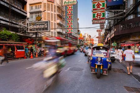 city fish market sign: Bangkok, Thailand - April 24, 2016: Tuk-tuk taxi parked near street market in Chinatown on April 24, 2016 in Bangkok, Thailand.
