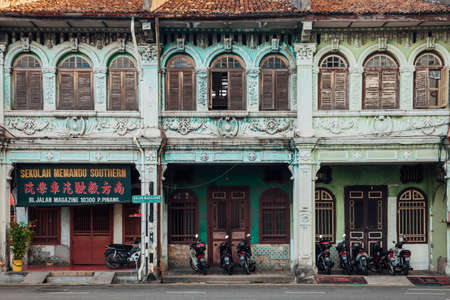 penang: George Town, Malaysia - March 27, 2016: Facade of the old building located in UNESCO Heritage Buffer Zone, George Town, Penang, Malaysia on March 27, 2016.