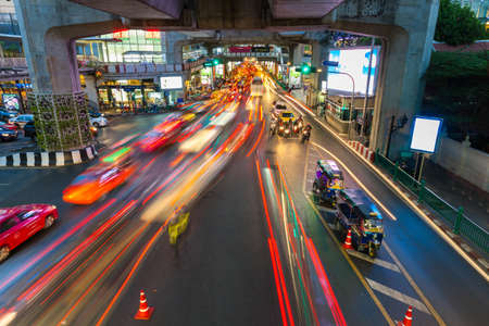 Bangkok, Thailand - April 22, 2016: Cars moving down the road in the heavy traffic conditions at Siam Square on April 22, 2016 in Bangkok, Thailand.