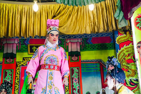 George Town, Malaysia - March 26, 2016: Actors playing traditional Chinese Opera on the street scene, George Town, Penang, Malaysia on March 26, 2016. Editorial