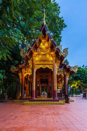 Dusk View of the Wat Phra Singh temple, the most revered temple in Chiang Mai, Thailand. Stock Photo