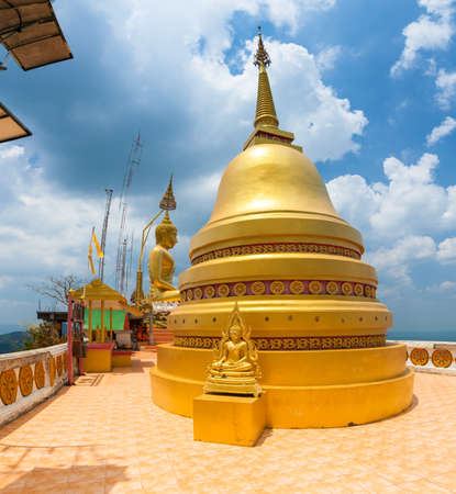 Krabi, Thailand - April 10, 2016: Golden Chedi on the top of Tiger Cave Temple on April 10, 2016 in Krabi, Thailand