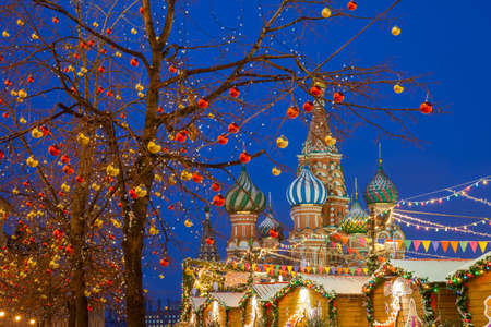 Christmas decorations at the Red Square with St. Basils Cathedral on the background, Moscow, Russia Фото со стока