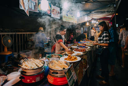 Chiang Mai, Thailand - August 27, 2016:  Thai woman sales at the Saturday Night Market on August 27, 2016 in Chiang Mai, Thailand.