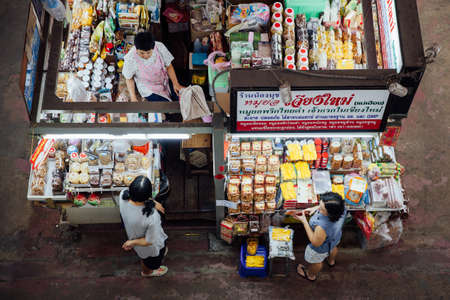 Chiang Mai, Thailand - August 27, 2016:  The group of vendors wait for customers at the Warorot market on August 27, 2016 in Chiang Mai, Thailand.