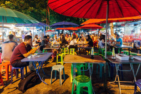 Chiang Mai, Thailand - August 27, 2016:  People eat at the street cafe on Saturday Night Market on August 27, 2016 in Chiang Mai, Thailand.