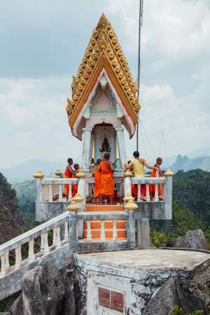 Krabi, Thailand - April 10, 2016: Novice monks are observing hilltop of the Tiger Cave Mountain Temple on April 10, 2016 in Krabi, Thailand.
