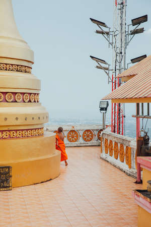 Krabi, Thailand - April 10, 2016: Novice monk observe the hilltop of the Tiger Cave Mountain Temple on April 10, 2016 in Krabi, Thailand.