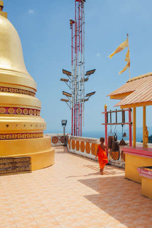 Krabi, Thailand - April 10, 2016: Novice monk observes hilltop of the Tiger Cave Mountain Temple on April 10, 2016 in Krabi, Thailand.