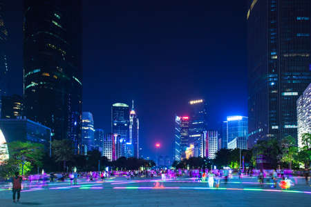 Guangzhou, China - October 4, 2016: Dusk view of the  Flower Square and modern skyscrapers in Guangzhou downtown, China on Octover 4, 2016. Редакционное