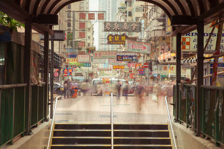 Hong Kong, China - February 18, 2014: Blurred motion of people going down the stairs of underground crossing on February 18, 2014 in Kowloon, Hong Kong. Редакционное