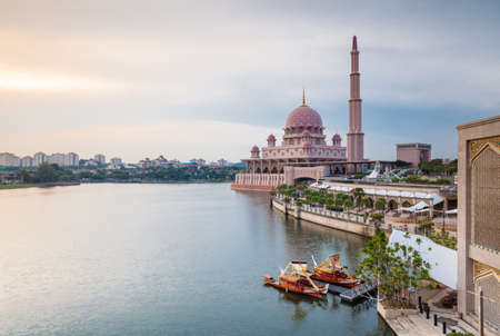 Beautiful pink Putra Mosque at sunset, Putrajaya, Malaysia Фото со стока