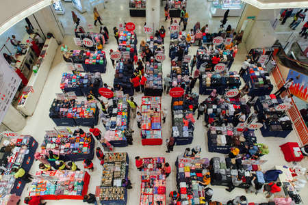 Kuala Lumpur, Malaysia - September 22, 2016: People choose clothes at the sale in the mall in Kuala Lumpur, Malaysia on September 22, 2016.