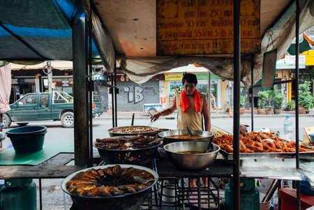 Bangkok, Thailand - September 11, 2016: Street vendor cooking on the street on September 11, 2016 in Bangkok, Thailand