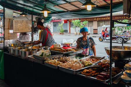 Bangkok, Thailand - September 11, 2016: Street vendors cooking on the street on September 11, 2016 in Bangkok, Thailand