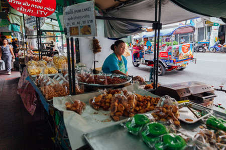Bangkok, Thailand - September 11, 2016: Vendor cooking on the street on September 11, 2016 in Bangkok, Thailand