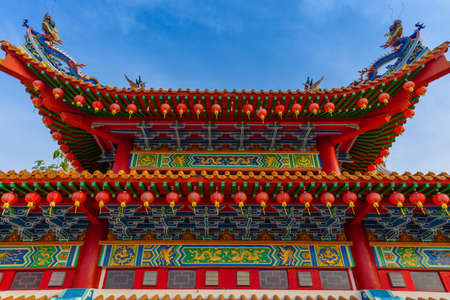 The roof of the Thean Hou Temple decorated with dragons and red Chinese lanterns, Kuala Lumpur, Malaysia