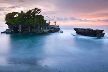 Pura Tanah Lot at sunset, famous ocean temple in Bali, Indonesia.