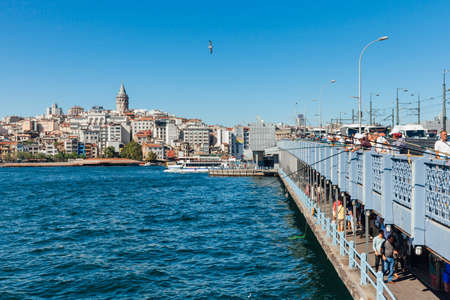 Istanbul, Turkey - August 14, 2018: Men catch fish from the Galata Bridge on August 14, 2018 in Istanbul, Turkey. Editorial