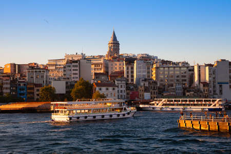 The beautiful view of the Galata Tower and Golden Horn at sunset, Istanbul, Turkey Фото со стока