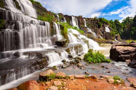 A long exposure of the beautiful Pongour waterfalls located near Dalat, Vietnam Фото со стока