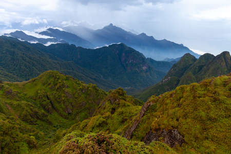Stunning view of the mountainous terrain from the summit of the highest Indochina peak, the Fansipan Mountain, Sapa, Lao Cai, Vietnam Фото со стока