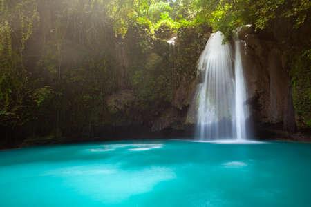 Incredible turquoise-colored Kawasan waterfalls located on Cebu Island, Philippines