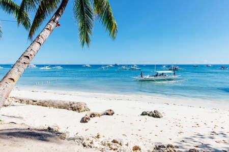 An idyllic view of the popular white sand Alona Beach located on Panglao Island, Bohol, Philippines