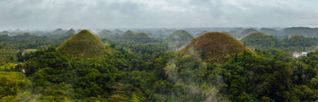 The panoramic view of the Chocolate Hills in rainy weather, Bohol, Philippines 免版税图像
