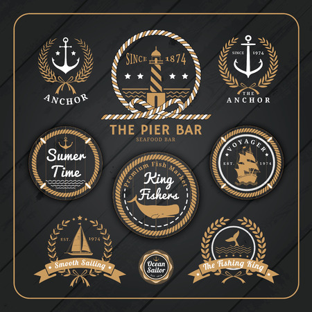fishing pier: Vintage nautical anchor labels with rope and laurel wreath design on dark wood background.