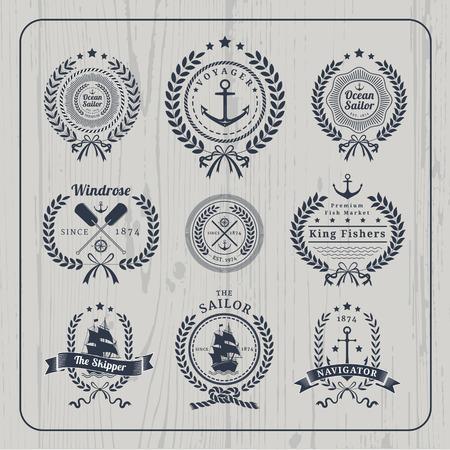Vintage nautical wreath labels logo set and design element on light wood background. Vettoriali