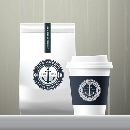 food products: Blue anchor coffee cup and food paper bag breakfast set on wood background